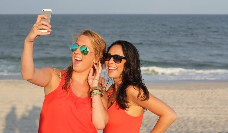 Friends on the beach with their phone